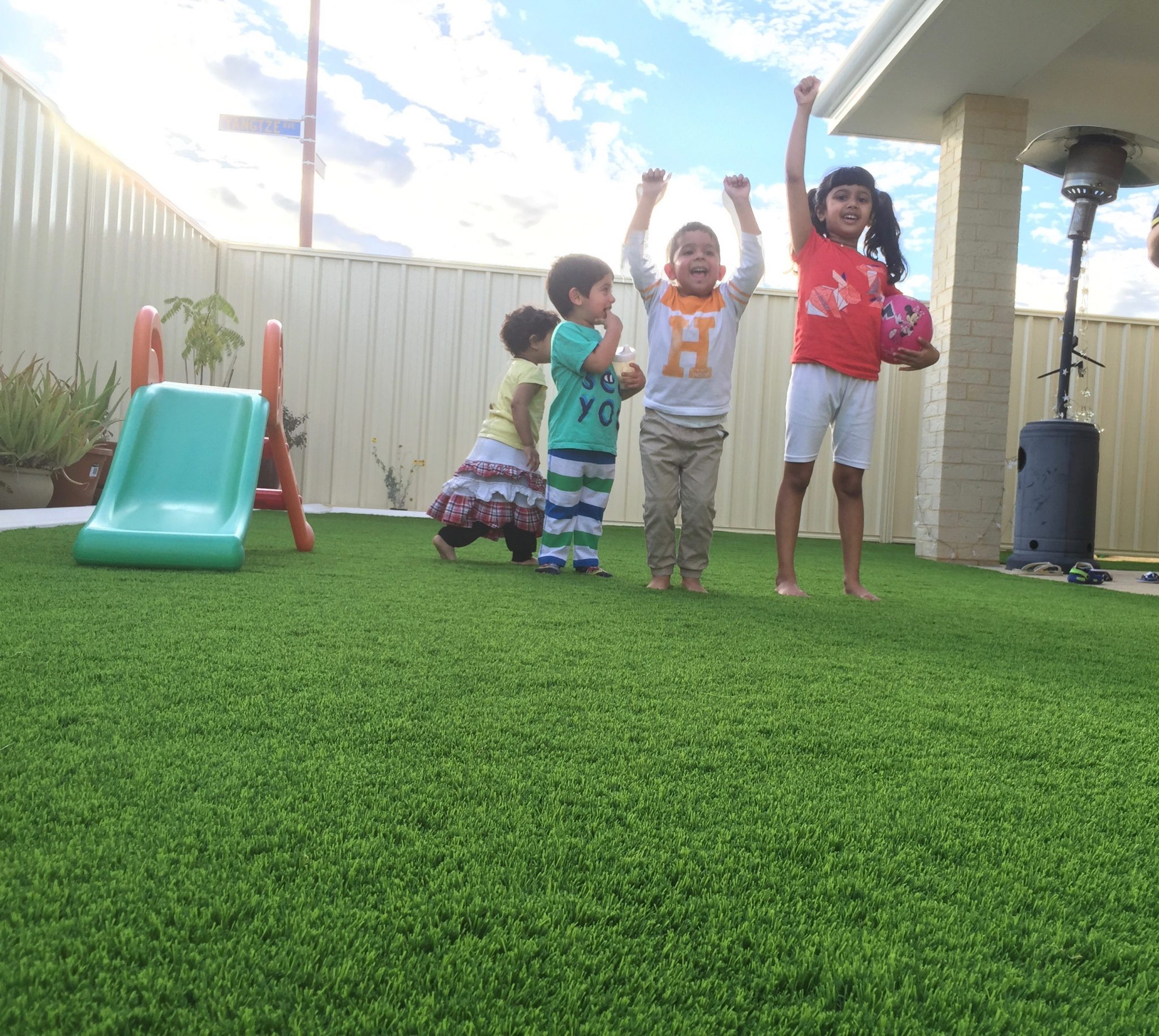 synthetic grass cost Perth kids playing on artificial grass