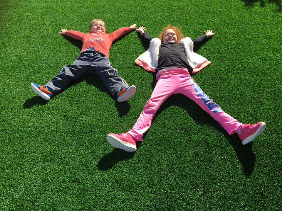 kids laying on Artificial grass in Marmion Perth WA