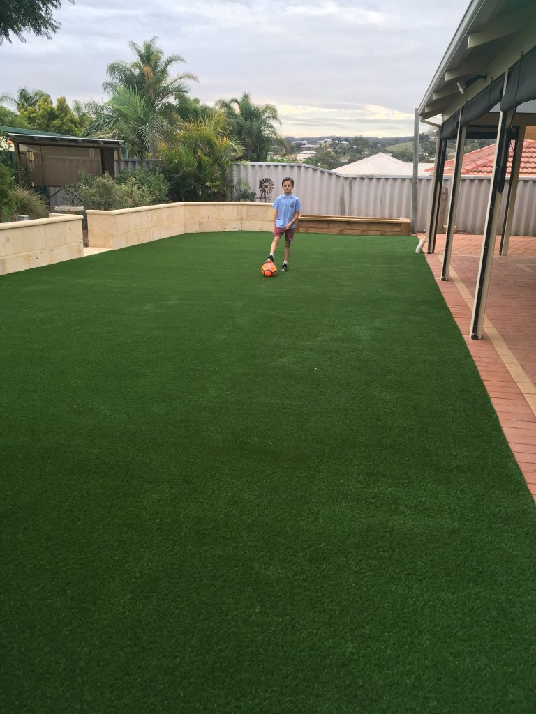 kids Playing on Artificial grass Perth home Back yard