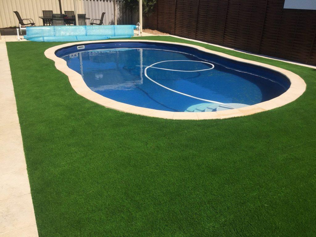 Artificial grass around the pool installation Wa turf gurus